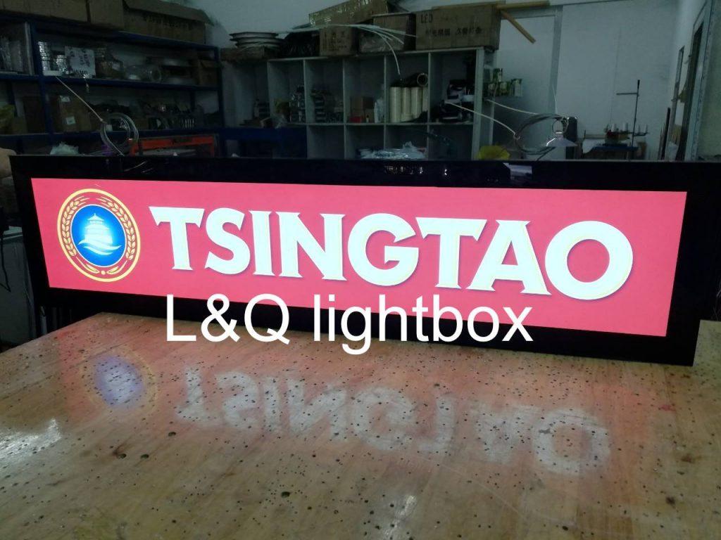 hộp đèn quảng cáo cho công ty tsingtao màu hồng